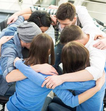 people having a group hug