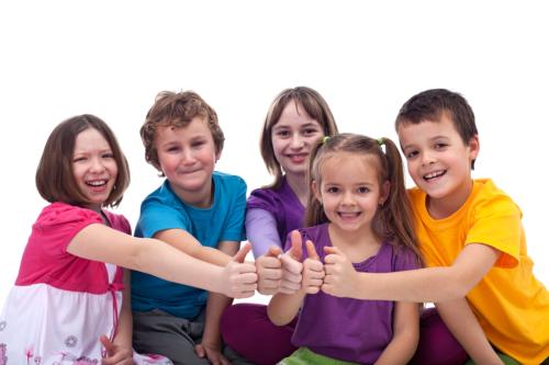 happy children doing thumbs up