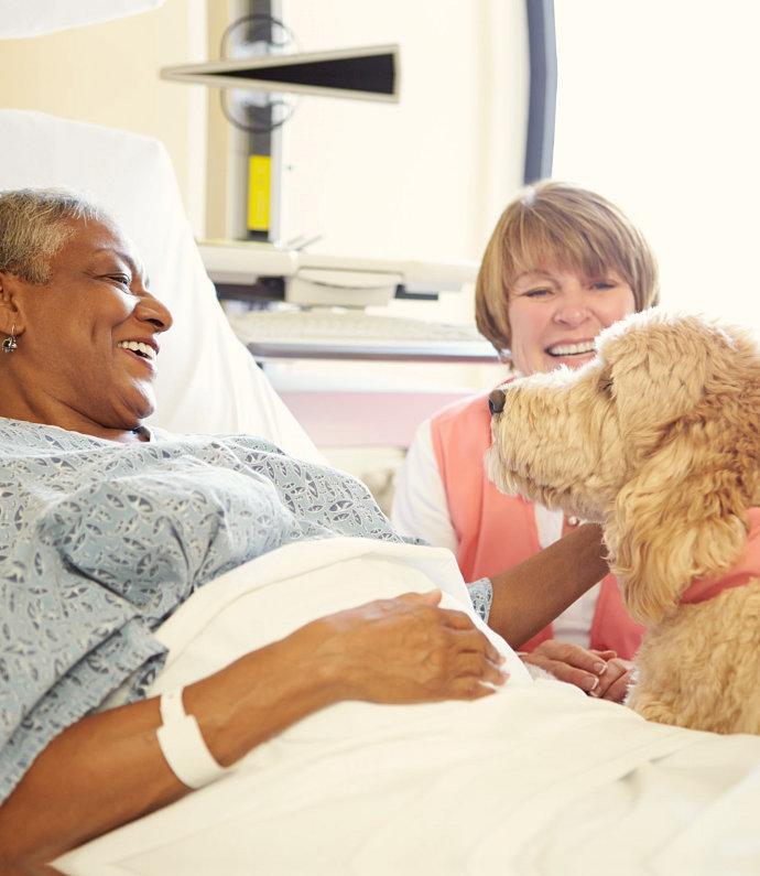 senior women smiling at the dog