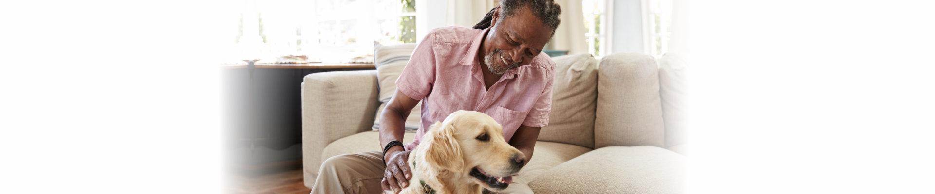 adult man petting a dog